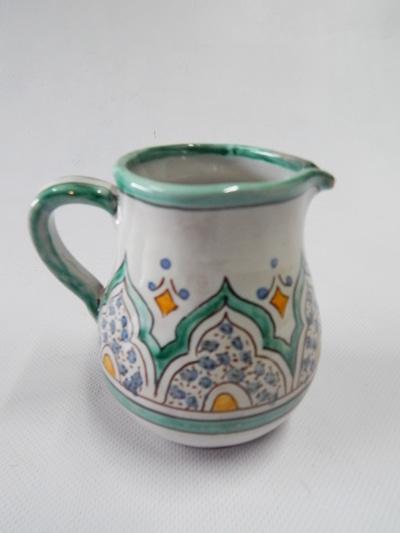 lechera de cerámica verde